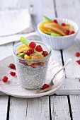 Coconut chia pudding with candied fruits in a glass