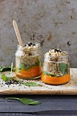 Quinoa with carrot cream in glass jars
