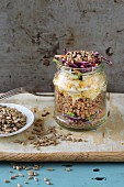 Buckwheat with scrambled eggs, red cabbage and sunflower seeds in a glass jar