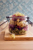 Lunch in a jar: vegan salad served in a glass jar