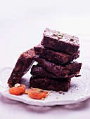 Brownies with pistachios, stacked on a plate