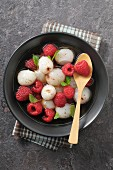 Lychees and raspberries in champagne sauce