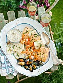 A mixed grill plate with fish, seafood and herb mayo