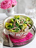 Lettuce with peas, ham and onions