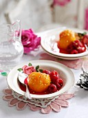 Poached peaches with rose water, pistachios and raspberries