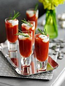 Grilled tomato soup with basil cream in shot glasses
