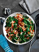 Sautéed spinach with bacon and tomatoes