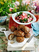 Spicy meatballs with a radish and watercress salad