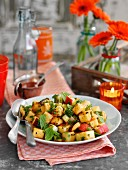 Warm potato salad with apple and mint