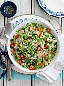 Vegetarian rice salad with tomatoes, celery and pea pods