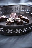 Vegan cake bars made from black beans and covered in chocolate