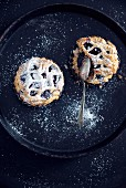 Vegan blueberry cakes with powdered sugar