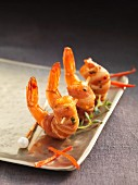 Bacon-wrapped prawns on cocktail sticks
