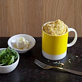 A savoury mug cake with feta and pine nuts