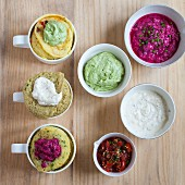 Mug cakes with different dips as a topping (seen from above)