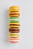 Row of macarons of various tastes and colours on white