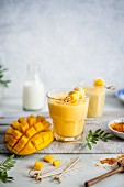 Mango lassi with turmeric and honey, fresh mango on a side