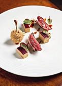 Taube, Foie gras und Haselnuss, im 'Winter Garden by Caino', Florenz, Italien