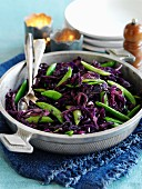 Red cabbage with onion and sugar snap peas
