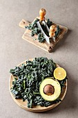 Fresh leaves of Kale salad with avocado, and lemon, Italian Cuisine