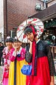 Young Korean males wearing women's clothing in Bukchon Hanok Village, Seoul, South Korea