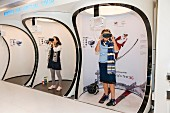 People trying out virtual reality goggles at the K-Style Hub in Seoul, South Korea