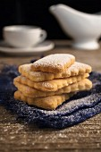 Homemade biscuits with icing sugar to be served with coffee