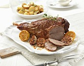 Roast leg of lamb with garlic and lemons