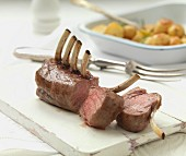 A rack of lamb with roast potatoes