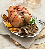 A roast chicken with strips of bacon