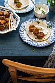 Falafel skewers with flatbread and dip