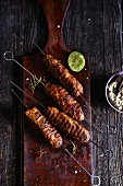 Grilled lamb mince kebabs on a chopping board