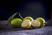 Whole and halved lemons