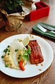 Teriyaki salmon with mashed potato and peas