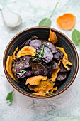 Homemade sweet potato and blue potato crisps