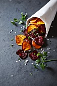 Homemade sweet potato and beetroot crisps in a paper bag