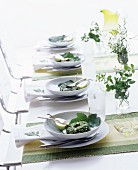 Table settings with herb cheese and pears