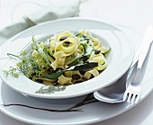 Tagliatelle with cucumber strips and dill