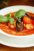 Tomato soup with seafood and basil