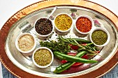 Various Oriental spices in small dishes on a serving platter