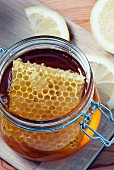 Greek organic honey with honeycomb in a glass jar