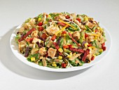 Southwest chicken salad with sweetcorn, salami and red and yellow pepper (USA)