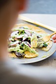 Mexican Socca (pancake made of chickpea flour) with pesto, mushrooms and radishes