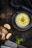Leek cream soup with hazelnuts and bread (top view)