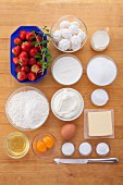 Ingredients for cupcakes with strawberry mascarpone cream