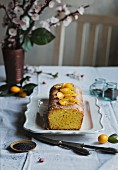 Tangerine loaf cake over the table