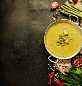 Asparagus cream soup on dark rustic background