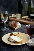 Fromage Fort Cheese Spread served with French bread, spicy pecans, quince jam, Manchego, olives, pears and an assortment of wine