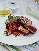 Grilled tuna steaks with vegetable skewers