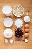 Ingredients for quick cream biscuit slices with almond flakes